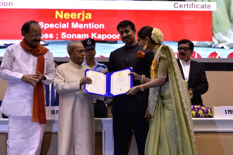 "Actress Sonam Kapoor who won a Special Mention for her role in ""Neerja"", which was named the Best Hindi Film being felicitated by President Pranab Mukherjee at the 64th National ... - Sonam Kapoor, M. Venkaiah Naidu, Pranab Mukherjee and Rajyavardhan Singh Rathore"