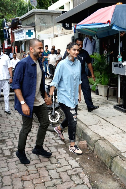 Actress Sonam Kapoor with her husband Anand Ahuja at the launch of a shoe store in Mumbai on July 27, 2018. - Sonam Kapoor