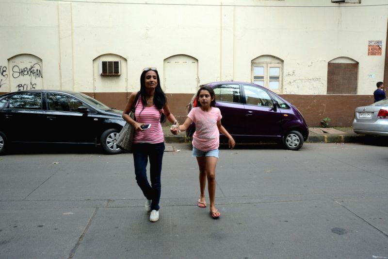 Actress Suchitra Pillai with her daughter Annika Kjeldsen seen at Mumbai's Juhu on July 29, 2018. - Suchitra Pillai