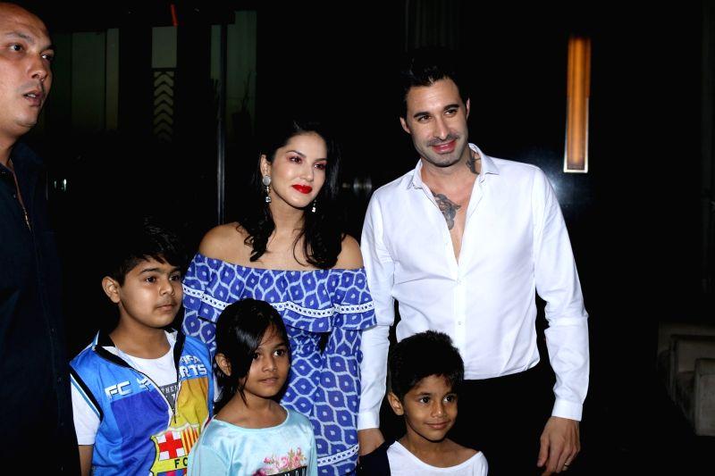 Actress Sunny Leone along with har husband Daniel Weber during fashion designer Maheka Mirpuri summer collection, in Mumbai on April 8, 2017. - Sunny Leone