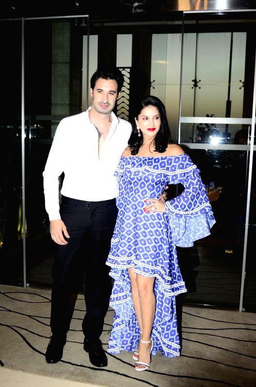 Actress Sunny Leone along with her husband Daniel Weber during fashion designer Maheka Mirpuri summer collection in Mumbai on April 8, 2017. - Sunny Leone