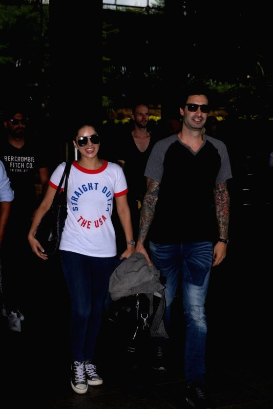 Actress Sunny Leone along with her husband Daniel Weber spotted at airport in Mumbai on May 24, 2017. - Sunny Leone