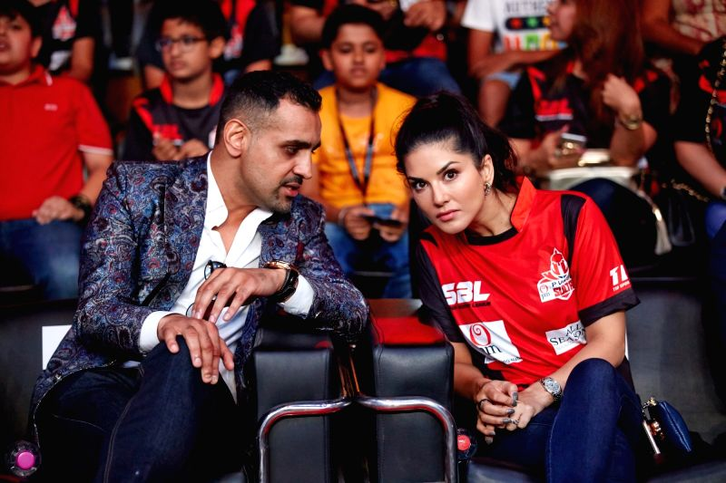 Actress Sunny Leone and Super Boxing League (SBL) founder and CEO Bill Dosanjh during Super Boxing League (SBL) match in New Delhi on July 28, 2017. - Sunny Leone