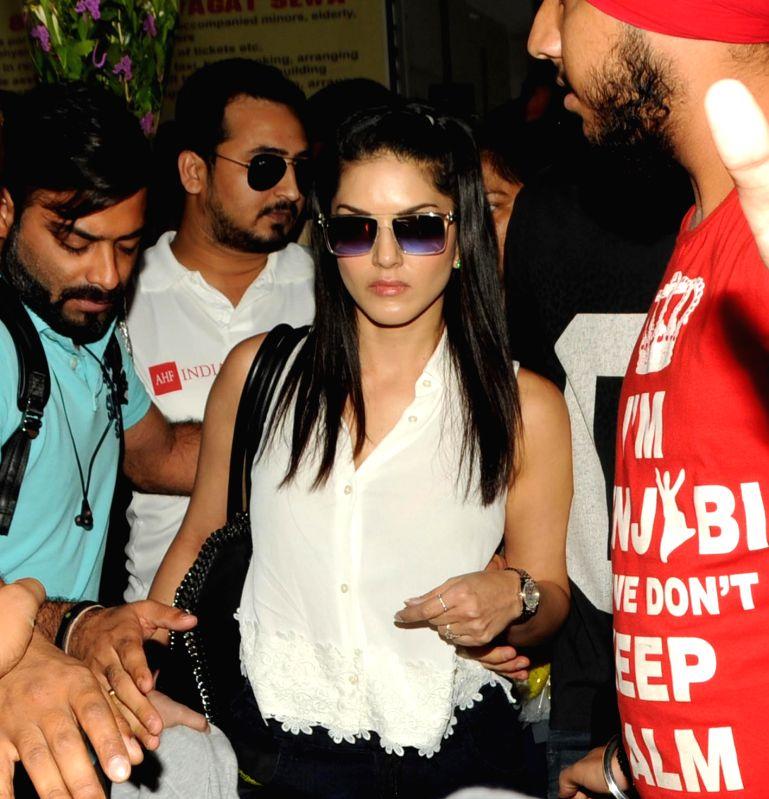 Actress Sunny Leone arrives at Birsa Munda Airport in Ranchi on May 27, 2017. - Sunny Leone and Birsa Munda Airport