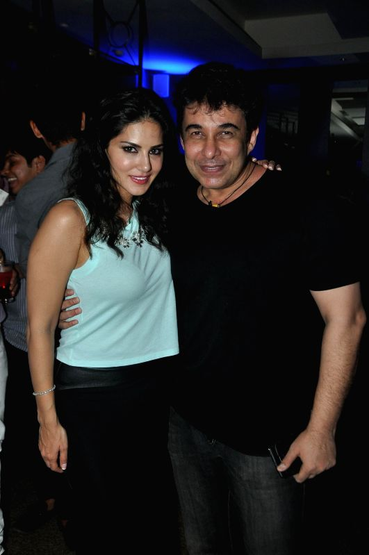 Actress Sunny Leone with actor Deepak Tijori during her birthday celebrations in Mumbai on May 13, 2014.