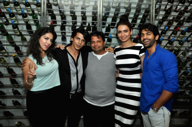Actress Sunny Leone with filmmakers Amaan Khan, Devang Dholkia, actress Karishma Tanna and Taaha Shah during her birthday celebrations in Mumbai on May 13, 2014. - Amaan Khan and Taaha Shah
