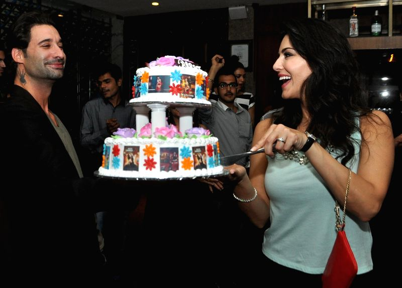 Actress Sunny Leone with her husband Daniel Webber during her birthday celebrations in Mumbai on May 13, 2014.