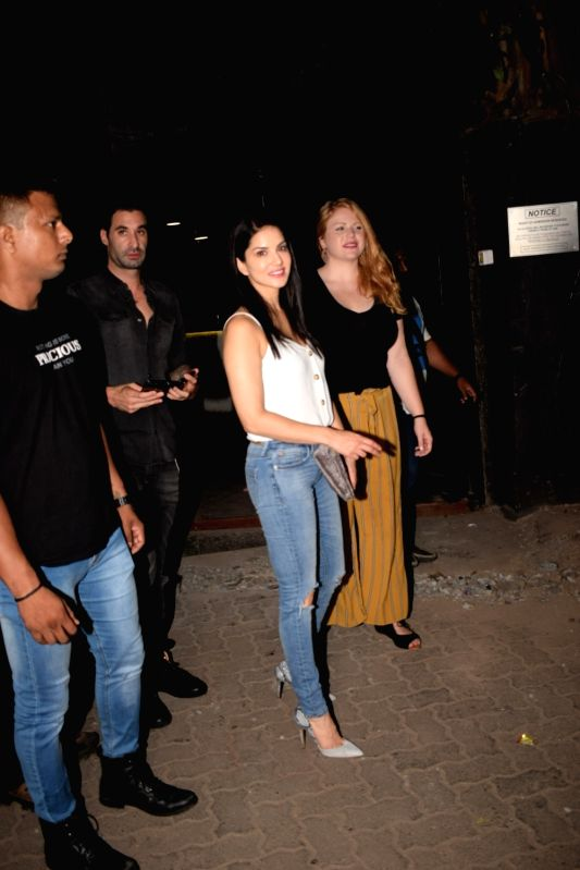 Actress Sunny Leone with her husband Daniel Weber seen at Mumbai's Juhu on May 18, 2018. - Sunny Leone