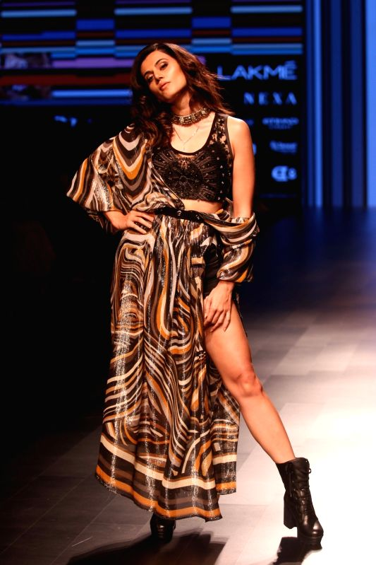 Actress Taapsee Pannu walks the ramp for fashion designer Ritu Kumar during the Lakme Fashion Week Summer/Resort 2018 in Mumbai on Jan 31, 2018. - Taapsee Pannu and Ritu Kumar