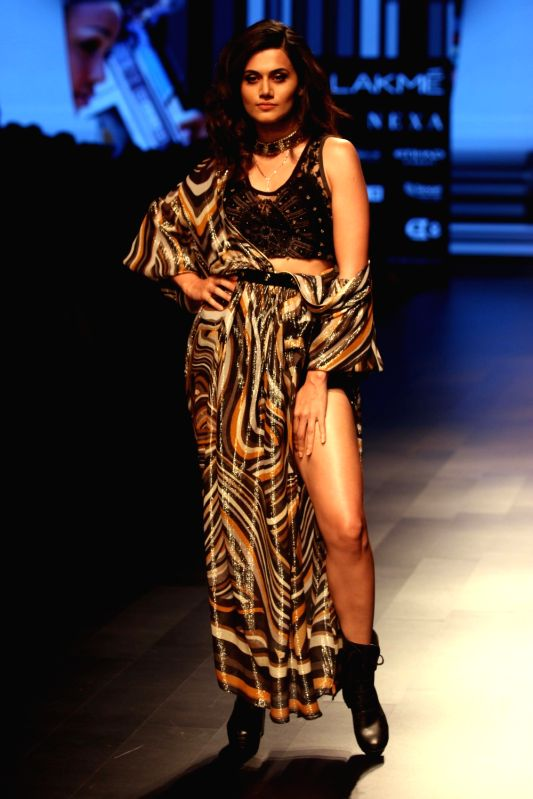 Actress Taapsee Pannu walks the ramp for fashion designer Ritu Kumar during the Lakme Fashion Week Summer/Resort 2018 in Mumbai on Jan 31, 2018. - Taapsee Pannu and Ritu Kumar