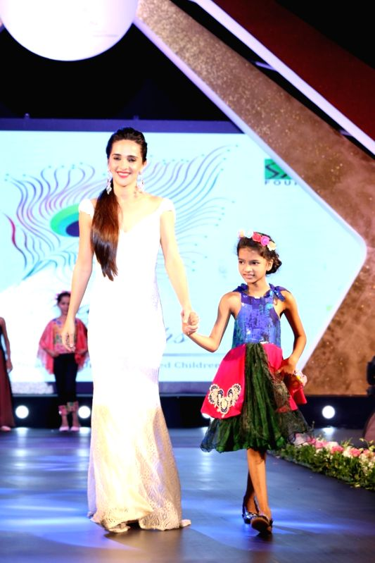 Actress Tara Sharma during the 11th edition of Ramp for Champs organised by NGO Smile Foundation, on Oct 13, 2016. - Tara Sharma