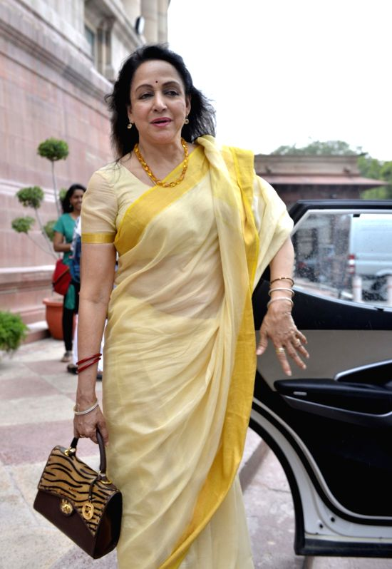Actress turned politician Hema Malini arrives at the Parliament to cast her vote in presidential polls on July 17, 2017. - Hema Malini