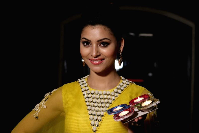 Actress Urvashi Rautela celebrates Diwali, The Hindu festival of lights in Mumbai on Oct 28, 2016.