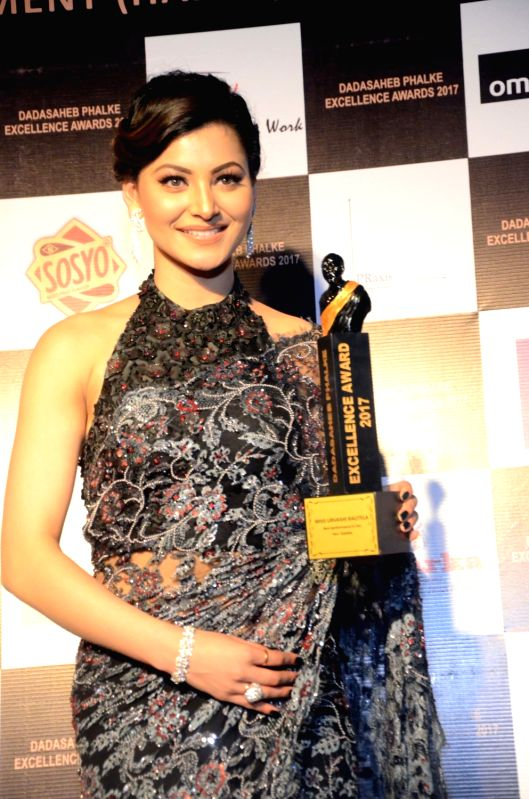 Actress Urvashi Rautela with the Dadasaheb Phalke award in Mumbai on April 21, 2017. - Urvashi Rautela