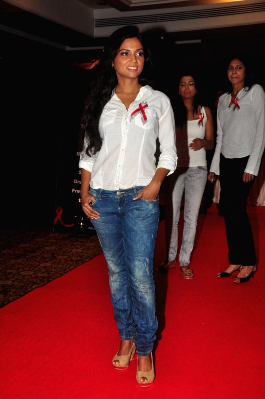Actress Usha Jadhav walks the ramp for AIDS awareness on World Aids Day to make India AIDs stigma free in Mumbai on Dec 1, 2014. - Usha Jadhav