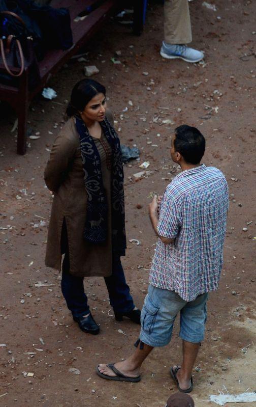 Actress Vidya Balan with director Sujoy Ghosh during shooting for their upcoming film `Te3n` at Writers Building in Kolkata on Nov 25, 2015. - Sujoy Ghosh