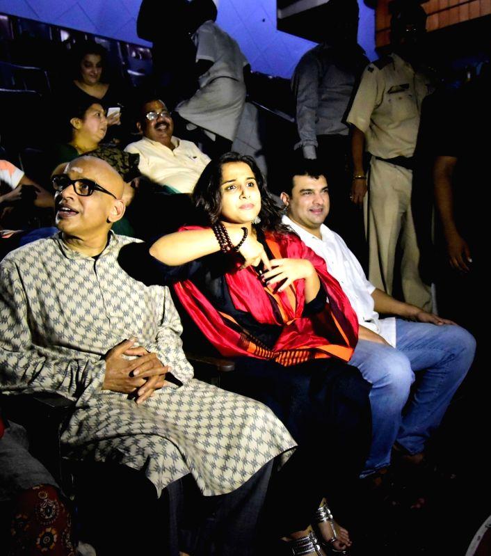 "Actress Vidya Balan with husband Aditya Roy Kapoor watching the film ""Kabali"", in Mumbai on July 24, 2016. - Vidya Balan and Roy Kapoor"