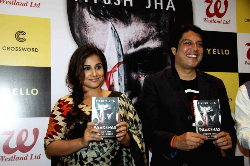 Actress Vidya Balanm and author Piyush Jha during the launch of his book Raakshas: India's no 1 Serial Killer in Mumbai on Dec 11, 2015. - Vidya Balanm