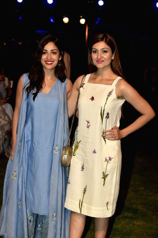 Actress Yami Gautam along with her sister Surilie Gautam during the Lakme Fashion Week Summer/Resort 2018 in Mumbai on Jan 31, 2018. - Yami Gautam