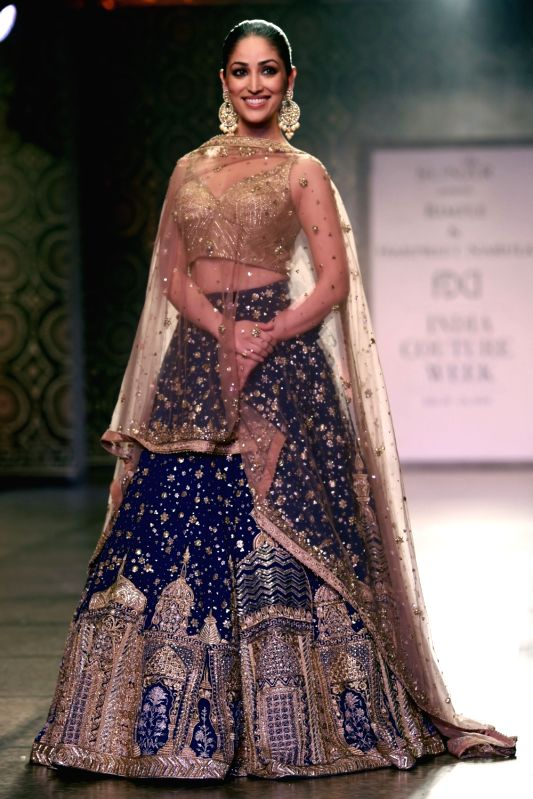 Actress Yami Gautam walks the ramp displaying an outfit by fashion designers Rimple and Harpreet Narula during the India Couture Week 2016, in New Delhi on July 22, 2016. - Yami Gautam