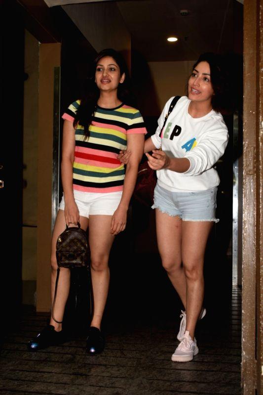 Actress Yami Gautam with her sister Surilie Gautam seen at a cinema theatre in Juhu, Mumbai on July 20, 2018. - Yami Gautam