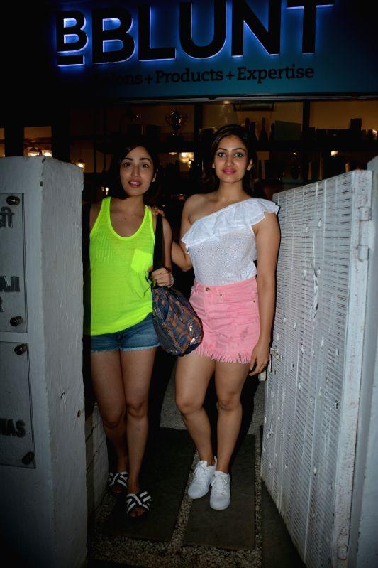 Actress Yami Gautam with her sister Surilie Gautam seen at a salon in Bandra, Mumbai on July 22, 2018. - Yami Gautam