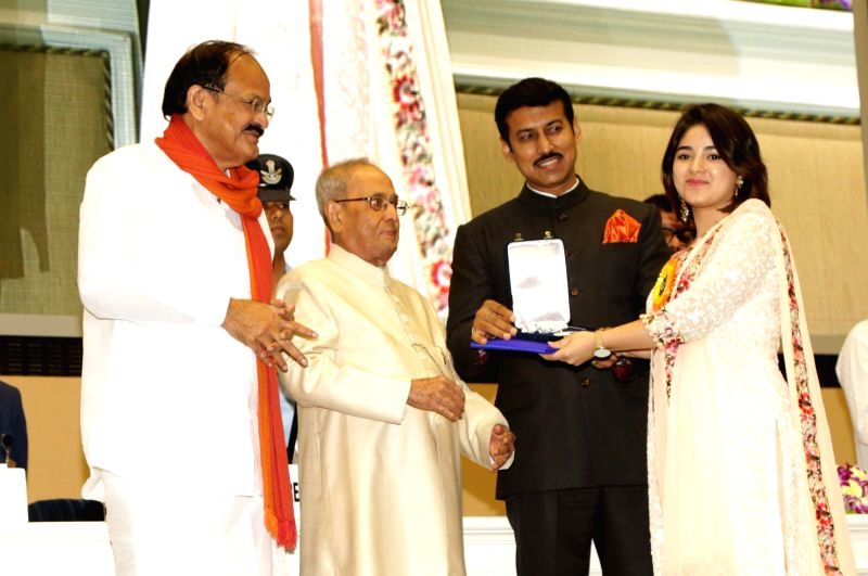 "Actress Zaira Wasim, who won the Best Supporting Actor award for Hindi film ""Dangal"" being felicitated by President Pranab Mukherjee at the 64th National Film Awards Function, in ... - Zaira Wasim, M. Venkaiah Naidu, Pranab Mukherjee and Rajyavardhan Singh Rathore"