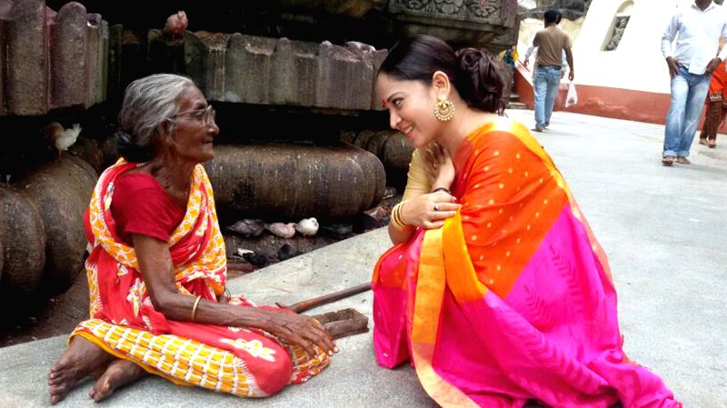 Actress Zerifa Wahid interacts with an old lady during her visit to Kamakhaya temple in Guwahati on July 3, 2014.