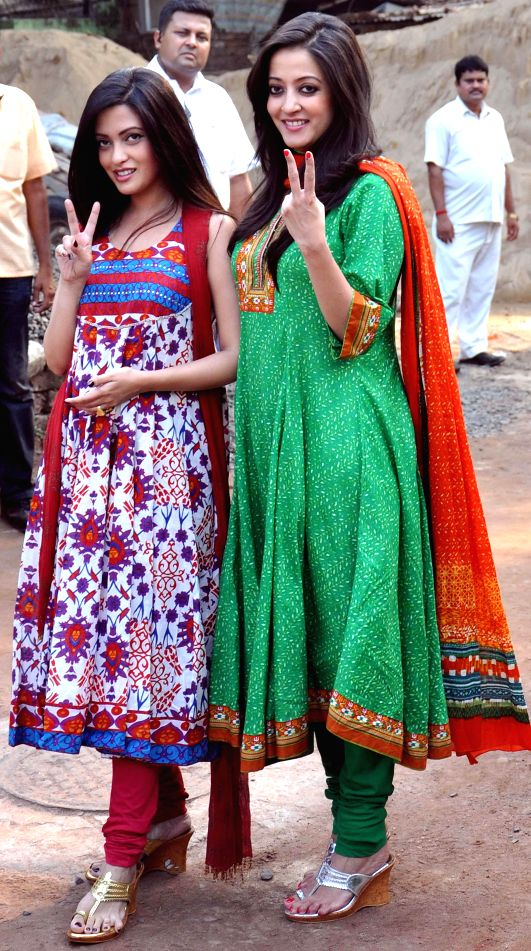 Actresses and daughters of Actor-turned-politician Moon Moon Sen arrive to attend a programme organised to celebrate Trinamool Congress's performance in 2014 Lok Sabha Elections at party supremo ...