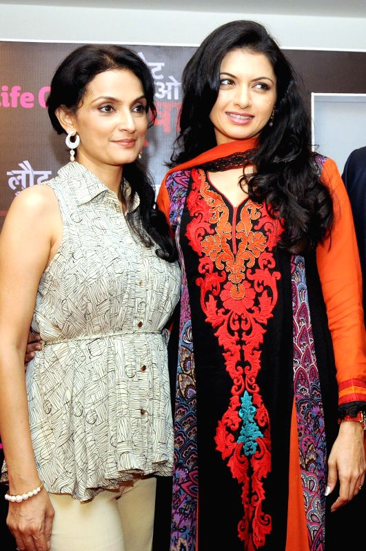Actresses Bhagyashree and Rajeshwari  during a press conference to promote their upcoming television soap `Laut Aao Trisha` in New Delhi on July 11, 2014. - Bhagyashree and Rajeshwari