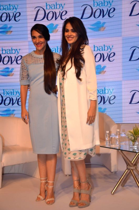 Actresses Genelia Deshmukh and Tara Sharma during the launch of a product in Mumbai on Oct 4, 2016. - Genelia Deshmukh and Tara Sharma