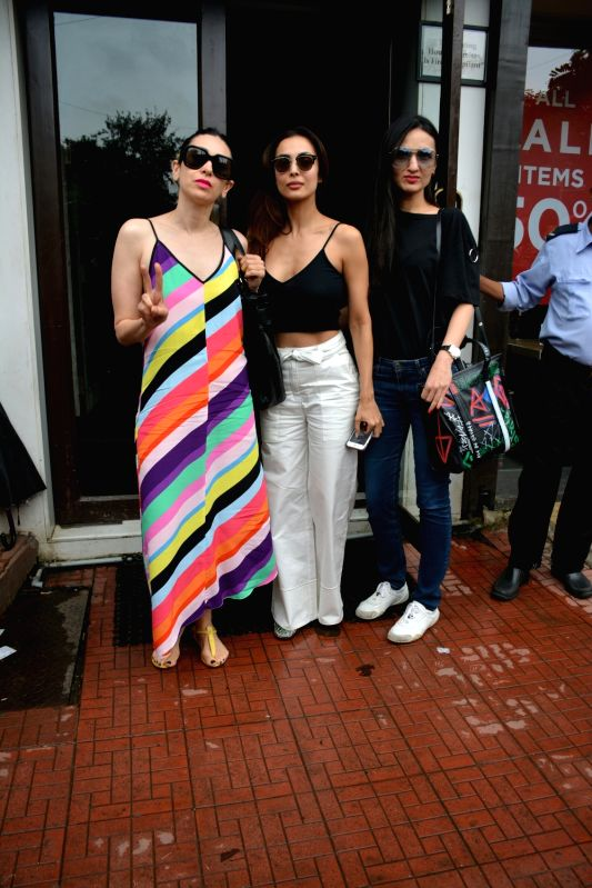 Actresses Karisma Kapoor, Malaika Arora and Anu Diwan seen at Mumbai's Bandra on July 18, 2018. - Karisma Kapoor, Malaika Arora and Anu Diwan