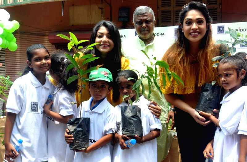 Actresses Mumtaz Sorcar and Debolina Kumar with special children during an environment awareness campaign in Kolkata on June 2, 2017. - Mumtaz Sorcar and Debolina Kumar