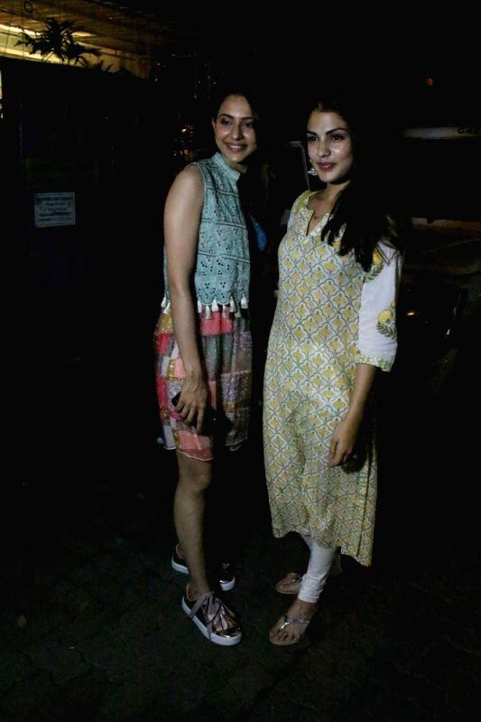 Actresses Rakul Preet Singh and Rhea Chakraborty at Mumbai's Bandra in Mumbai on June 11, 2018. - Rakul Preet Singh and Rhea Chakraborty