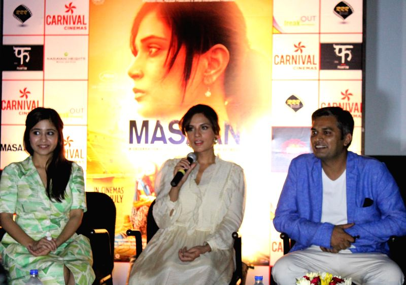 Actresses Richa Chadda and Shweta Tripathi along with director Neeraj Ghaywan during a press conference to promote their upcoming film `Massan` in Ahmedabad on July 17, 2015. - Richa Chadda and Shweta Tripathi