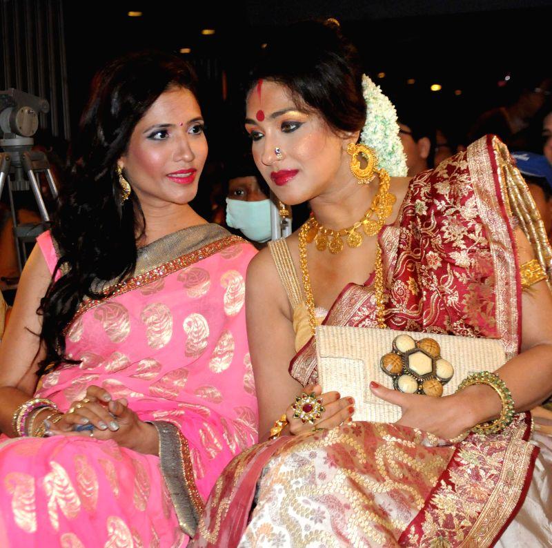 Actresses Rituparna Sengupta and Richa Sharma during a programme in Kolkata on August 1, 2014.