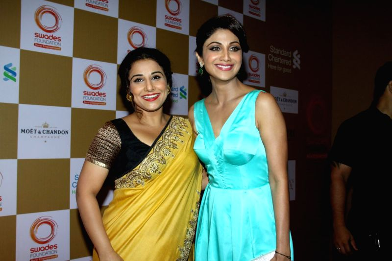 Actresses Vidya Balan and Shilpa Shetty Kundra during the launch of Van Heusen Spring Summer 2014 limited edition collection in Mumbai, on April 10, 2014. - Vidya Balan and Shilpa Shetty Kundra
