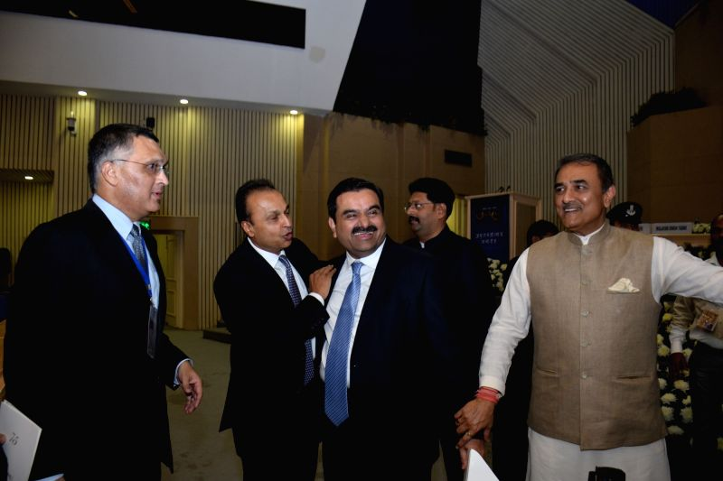 ADAG chairman Anil Ambani, Adani Group chairman Gautam Adani and NCP leader Praful Patel during the 75th birthday celebrations of Sharad Pawar in New Delhi on Dec 10, 2015. - Ambani and Praful Patel