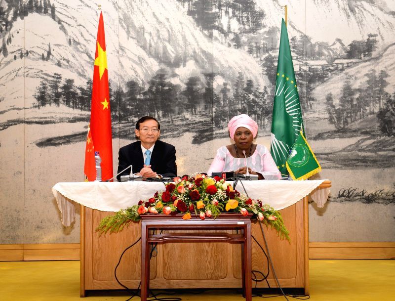 Zhang Ming (L), Special Envoy and Vice Foreign Minister of China, and Nkosazana Dlamini-Zuma, Chairperson of the African Union (AU) Commission, attend a signing