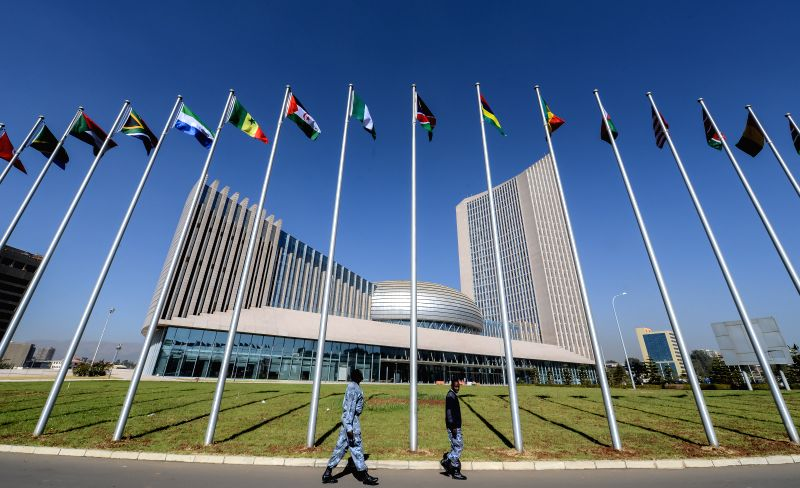 Security staff members walk pass the flagpoles outside the African Union (AU) Headquarters in Addis Ababa, capital of Ethiopia, on Jan. 28, 2014. The 24th AU ...