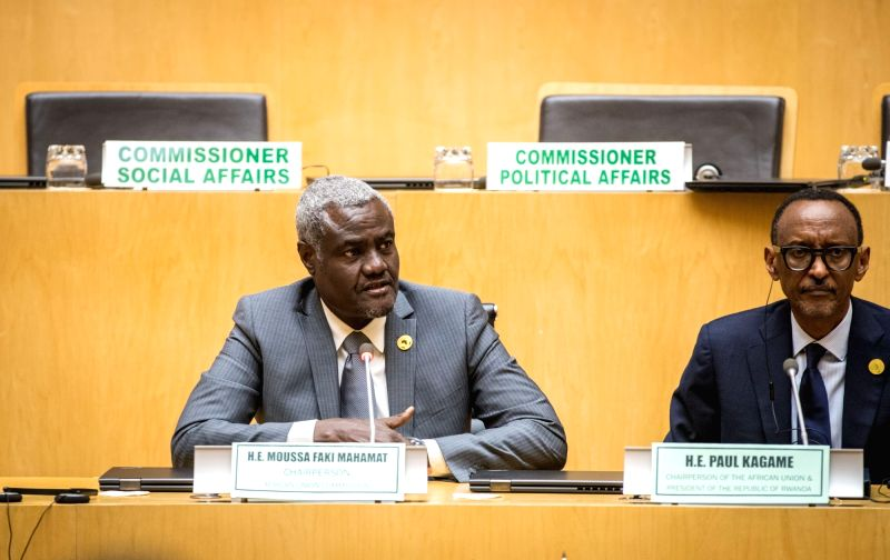 ADDIS ABABA, Jan. 29, 2018 - Moussa Faki Mahamat (L), Chairperson of the African Union (AU) Commission, speaks during a press conference after the closing ceremony of the 30th AU summit in Addis ...