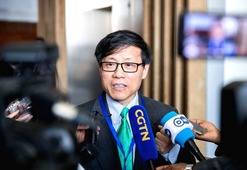 ADDIS ABABA, Jan. 30, 2018 - Kuang Weilin, head of the Chinese mission to the African Union (AU), speaks to media at the AU headquarters in Addis Ababa, capital of Ethiopia, Jan. 29, 2018. Ethiopian ... - Hailemariam Desalegn