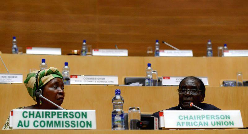 Nkosazana Dlamini-Zuma (L), Chairperson of the African Union (AU) Commission, and new rotating Chairman of the AU and Zimbabwean President Robert Mugabe attend .
