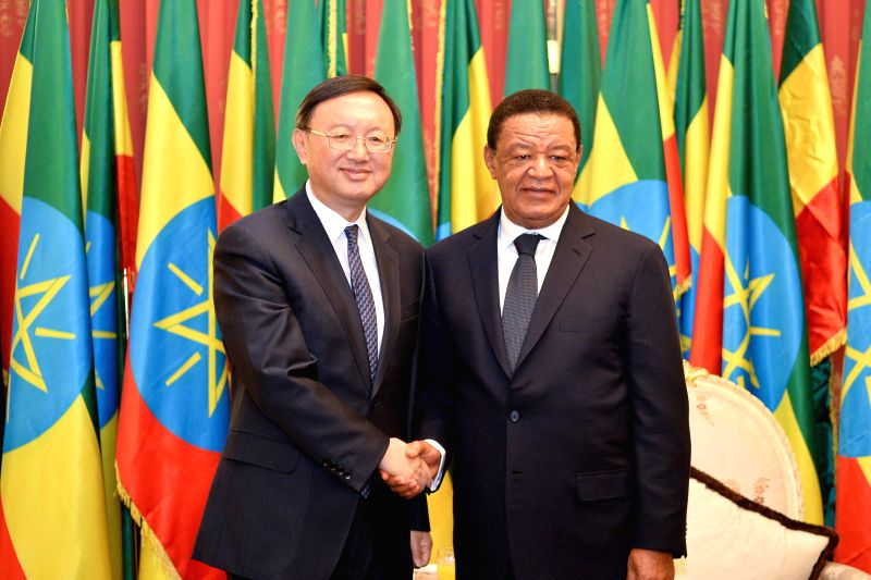ADDIS ABABA, March 20, 2017 - Ethiopian President Mulatu Teshome (R) shakes hands with visiting Chinese State Councilor Yang Jiechi during their meeting in Addis Ababa, Ethiopia, on March 20, 2017.