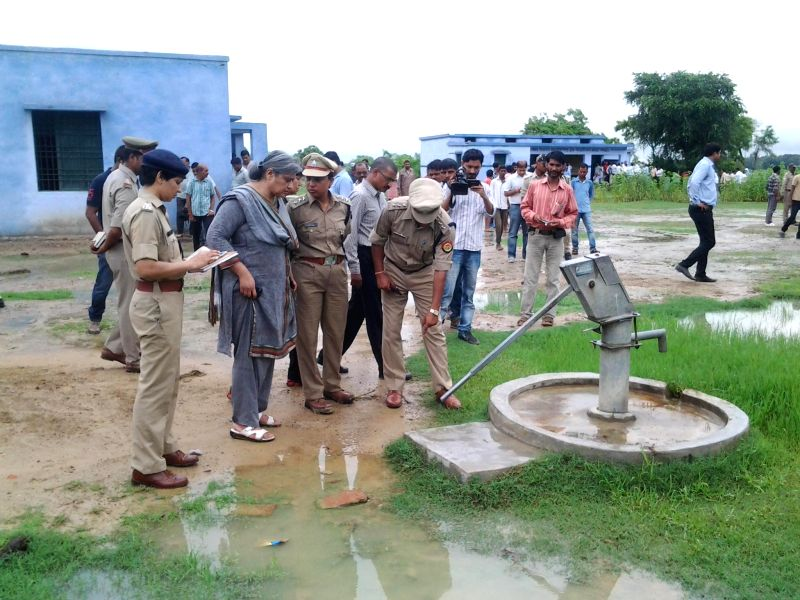Additional Director of Police (ADG) Sutapa Sanyal inspects the site at a primary school campus where a woman's bruised and wounded body was found, in Mohanlalganj on the outskirts of Lucknow on ...