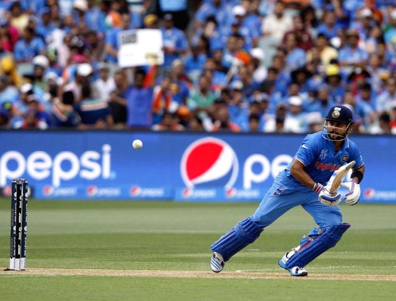 Indian cricketer Virat Kohli in action during an ICC World Cup 2015 match between India and Pakistan at Adelaide Oval in Adelaide, Australia on Feb 15, 2015. - Virat Kohli