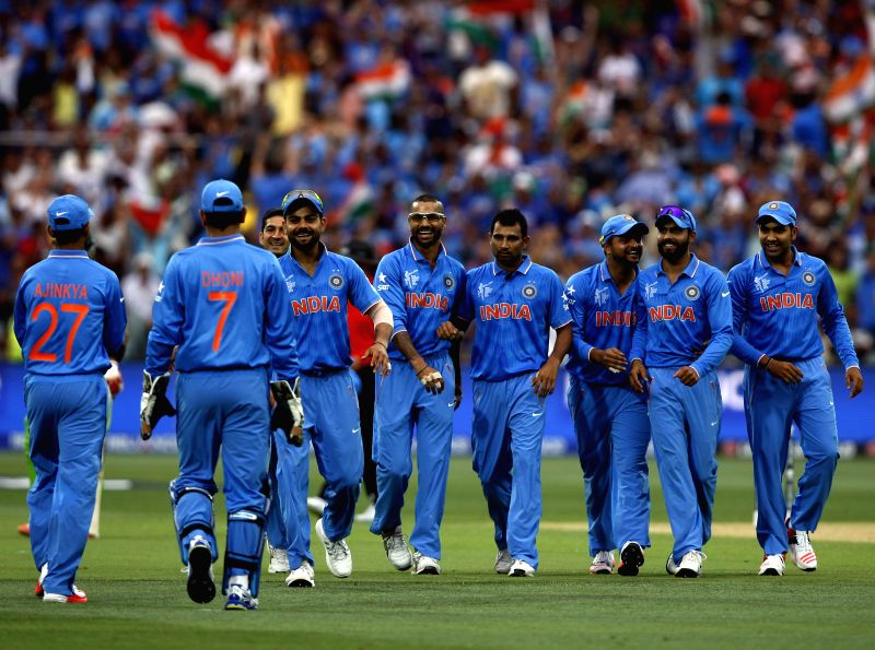 Adelaide : Indian cricketers celebrate fall of a wicket during an ICC World Cup 2015 match between India and Pakistan at Adelaide Oval in Adelaide, Australia on Feb 15, 2015.
