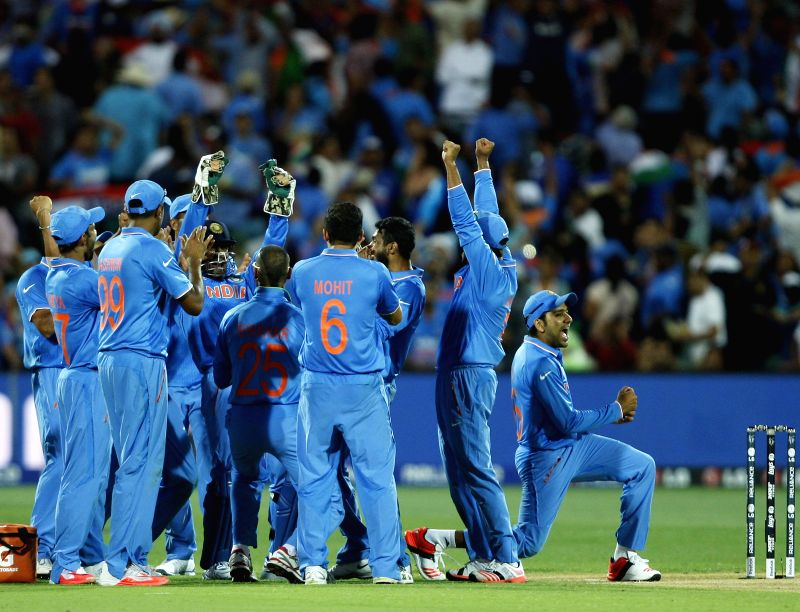 Indian cricketers celebrate fall of a wicket during an ICC World Cup 2015 match between India and Pakistan at Adelaide Oval in Adelaide, Australia on Feb 15, 2015.