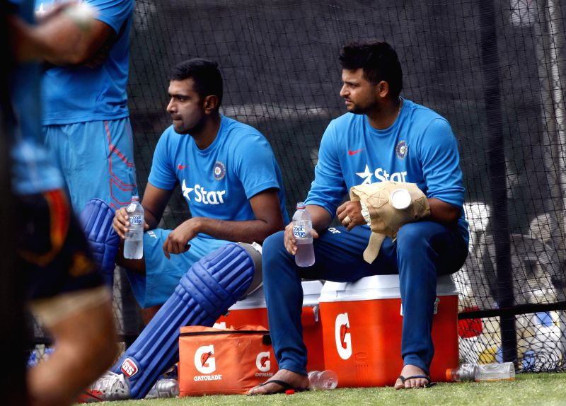 Indian cricketers Suresh Raina and Ravichandran Ashwin during an ICC World Cup - 2015 practice session at Adelaide Oval in Adelaide,  Australia on Feb 14, 2015.