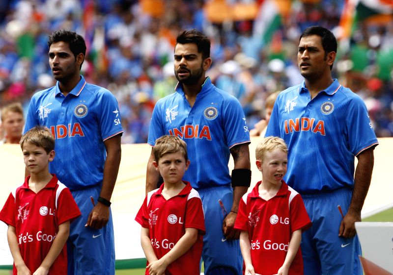 Indian team captain MS Dhoni, Virat Kohli and Bhuvneshwar Kumar during the cricket World Cup match between India and Pakistan at Adelaide on Feb. 15, 2015. - MS Dhoni, Virat Kohli and Bhuvneshwar Kumar